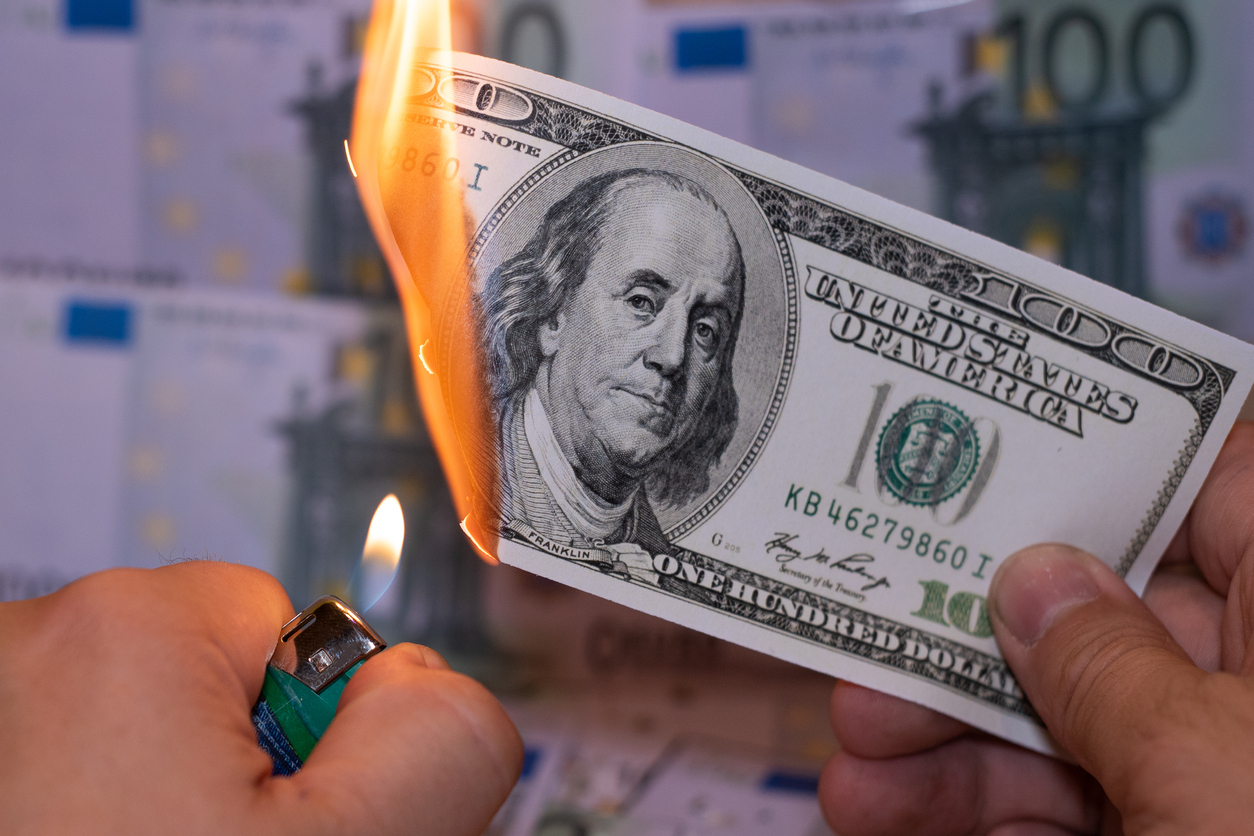 A hunred dollar bill in American US currency is on fire